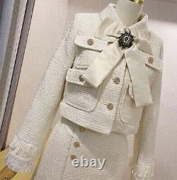 Cream tailored tweed chic gold button skirt blazer jacket suit set outfit lapel